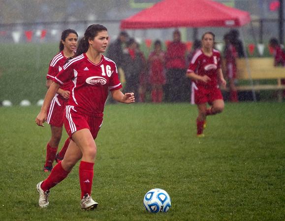 SAM HOUSEHOLDER   THE GOSHEN NEWS<br /> Goshen senior midfielder Jessica Oyer dribbles the ball during the regional game against Warsaw Wednesday.