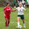 SAM HOUSEHOLDER | THE GOSHEN NEWS<br /> Concord junior Emma Paden kicks the ball away from Goshen senior Xenia Isaula Tuesday during the game.