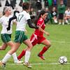 SAM HOUSEHOLDER | THE GOSHEN NEWS<br /> Goshen junior midfielder Xenia Isaula dribbles away from Concord junior midfielder Emma Paden (7) and senior forward/midfielder Tori Moore during the game Tuesday.