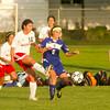 SAM HOUSEHOLDER | THE GOSHEN NEWS<br /> Goshen senior Jessica Oyer kicks the ball away from Mishawaka Marian player Gabby Lucchese Thursday during the game.