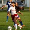 SAM HOUSEHOLDER | THE GOSHEN NEWS<br /> Goshen junior Jelitza Palomino dribbles the ball against Mishawaka Marian Thursday at Goshen High School.