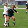 GREG KEIM | THE GOSHEN NEWS<br /> Northridge junior Emma Oxenrider and Penn sophomore Sydney Egendoefer go for the ball in the IHSAA Class 3A girls soccer regional Saturday at Tallman-Beyrer Field in South Bend. Penn was a 4-0 winner.