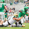Concord Minutemen running back Titus Hackworth (8) advances the ball against Wawasee Warriors defensive linemen Haegan Slusher (72) Saturday during the game at Concord High School in Elkhart.