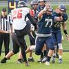 Fairfield Falcons defensive linemen Jason Massaro (77) attempts to block Fremont Eagles kicker Logan Brace (26)  Friday during the game at Fairfield Jr.-Sr. High School.