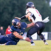 Fairfield Falcons linebacker Carson Abramson (36) dives to tackle Fremont Eagles quarter back Kameron Colclasure (5) Friday during the game at Fairfield Jr.-Sr. High School.