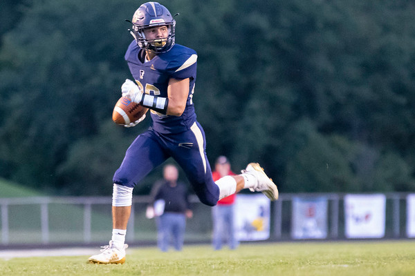 Fairfield Falcons defensive back Nathan Klinedinst (26) runs for a defensive touchdown after an interception Friday during the game at Fairfield Jr.-Sr. High School.