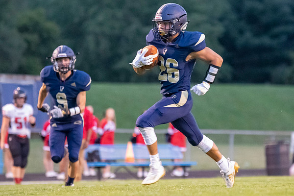 Fairfield Falcons defensive back Nathan Klinedinst (26) advances the ball for a defensive touchdown after an interception Friday during the game at Fairfield Jr.-Sr. High School.