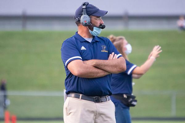Fairfield Falcons head coach Matt Thacker observes his team Friday before the game at Fairfield Jr.-Sr. High School.
