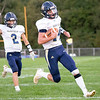 Fairfield Falcons quarterback Cory Lantz (14) runs the ball for a touchdown with his teammate Brock Short (2) during the game Friday at West Noble High School in Ligonier.