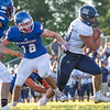 Fairfield Falcons linebacker Carson Abramson (36) advances the ball for a touchdown against West Noble Chargers Peter Bradley (18) during the game Friday at West Noble High School in Ligonier.