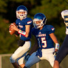 West Noble Chargers Derek Slone (5) drops back to pass the ball to his teammate during the game Friday at West Noble High School in Ligonier.
