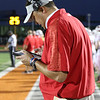 Goshen head coach Kyle Park reviews a play on the sidelines Friday night as the RedHawks visited the Tigers in Warsaw.