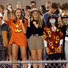 Fairfield Falcons student Gretchen Miller, middle, of Goshen, leads the student section in a chant during Friday's game at Fairfield High School Jr./Sr. High School in Goshen.