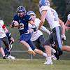 Fairfield Falcons halfback Dalton Cripe (22) advances the ball for positive yards during Friday's game at Fairfield High School Jr./Sr. High School in Goshen.