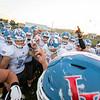 Lakeland Lancers football team huddles up before Friday's game at Fairfield High School Jr./Sr. High School in Goshen.