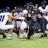 Northridge Raiders quarterback Logan Hooley (15) runs for positive yards against Leo Lions linebacker Carson Hoeppner (21) during Friday's game at Northridge High School in Middlebury.