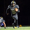 Northridge Raiders quarterback Logan Hooley (15) runs for positive yards against during Friday's game at Northridge High School in Middlebury.
