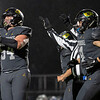Northridge Raiders center Zaryn Rumfelt (54) reacts after an extra point during Friday's game at Northridge High School in Middlebury.