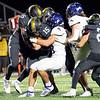 Northridge Raiders quarterback Logan Hooley (15) advances the ball during Friday's game at Northridge High School in Middlebury.
