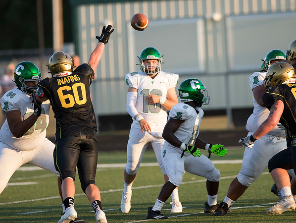 Concord quarterback Hunter Dutton throws a pass against Wawasee Friday.