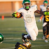 Concord running back Titus Hackworth leaps a Wawasee defender during the game Friday.