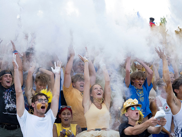 Elkhart Lion's student section tosses baby powder in the air  at the start of Friday's game at Elkhart High School. Also pictured Concord senior Zaven Koltookian (35).