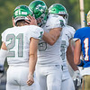 Concord junior Armen Koltookian (9) reacts after a play with his teammate junior James Lewis (21) during Friday's game at Elkhart High School. Also pictured Concord senior Zaven Koltookian (35).