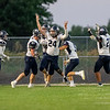 Garrett senior Carson Harter (24) celebrates a touchdown with his teammates during Friday's game at Lakeland High School in LaGrange.