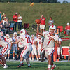 Goshen junior quarterback Deecon Hill passes the ball as one of many flags is in the air during the RedHawks game against Fairfield Friday in Benton.