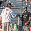 Goshen head coach Kyle Park and Northwood head coach Nate Andrews bump fists before the start of Friday night's NLC matchup between the RedHawks and the Panthers in Nappanee.