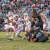 Goshen senior Brayden Hinkel returns a kickoff and evades multiple Northwood defenders as the RedHawks traveled to Nappanee Friday night to take on the Panthers.