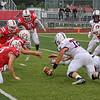 As the ball is fumbled by Mishawaka, a host of players reach for it and Goshen senior Brayden Hinkel ends up with it for a Mishawaka turnover Friday night on Foreman Field in Goshen.