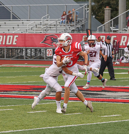 Goshen junior Jake Turner grabs a pass before being tackled by a Mishawaka defender during the first half of NLC action Friday night on Foreman Field in Goshen.