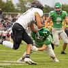 Concord senior Jack D'Arcy (7) makes a tackle against NorthWood junior Keegin Stats (25) during Friday's game at Concord High School in Dunlap.