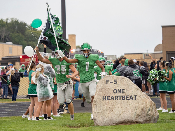 Concord senior Amarion Moore (1) leads his teammates to take the field before Friday's game at Concord High School in Dunlap.