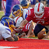 Goshen sophomore Ryan Eldridge (67) recovers a fumble for a touchdown during Friday's game at Goshen High School.