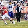 Goshen junior Adam Ellison (20) runs for positive yards during Friday's game at Goshen High School.