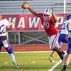 Goshen senior Duncan Green (49) swats the ball against South Bend Clay senior Julis Bagarus (22) during Friday's game at Goshen High School.