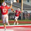 Goshen junior Noah Alford (10) reacts after scoring a touchdown during Friday's game at Goshen High School.