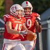 Goshen senior Roman Schrock (45) reacts after a touchdown during Friday's game at Goshen High School.