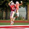 Goshen junior Noah Alford (10) celebrates after scoring a touchdown during Friday's game at Goshen High School.