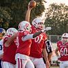 Goshen sophomore Ryan Eldridge (67) reacts after scoring a touchdown during Friday's game at Goshen High School.