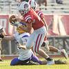 Goshen senior Roman Schrock (45) intercepts the ball during Friday's game at Goshen High School.