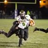 SAM HOUSEHOLDER | THE GOSHEN NEWS<br /> Northridge senior running back Travis Slabach breaks through a Leo tackler during the sectional championship game Friday.