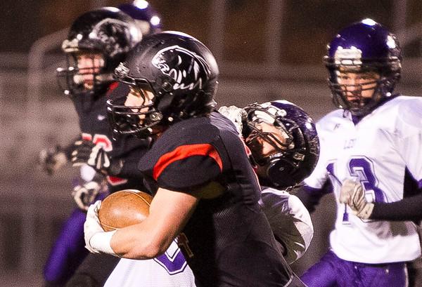 SAM HOUSEHOLDER | THE GOSHEN NEWS<br /> NorthWood junior running back Tanner Cleveland stiff arms a Leo defender during the sectional game.