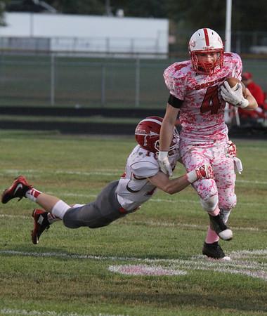 SAM HOUSEHOLDER | THE GOSHEN NEWS<br /> Goshen senior Brady Bechtel tackles Plymouthsenior Cam Eveland during the game Friday.