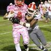 SAM HOUSEHOLDER | THE GOSHEN NEWS<br /> Goshen junior Rummel Johnson tackles Plymouth senior Cam Eveland during the game Friday.