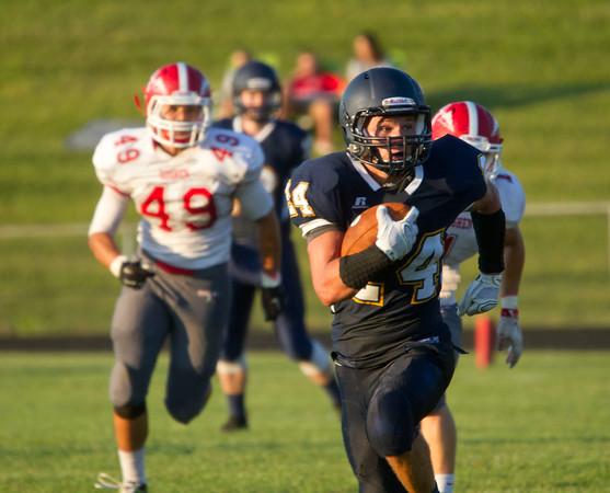 SAM HOUSEHOLDER | THE GOSHEN NEWS<br /> Fairfield senior running back Mitch Dewitt runs with the ball from Goshen defenders senior Jordan Holley (49) and junior Dylan Black (1) during the game Friday.
