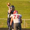 SAM HOUSEHOLDER | THE GOSHEN NEWS<br /> Fairfield quarterback senior Sam Brown throws the ball as he is pressured by Goshen senior Derek Paz during the game Friday.