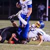 SAM HOUSEHOLDER | THE GOSHEN NEWS<br /> NorthWood sophomore Will Ingle tackles East Noble quarterback sophomore Andrew McCormick during the game Friday.
